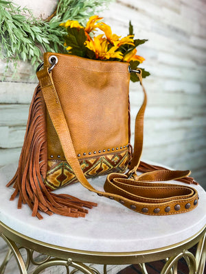 Medium Brown Crossbody with Embossed Teal Aztec Pattern and Brown Fringe on the Sides and Studded Crossbody Strap