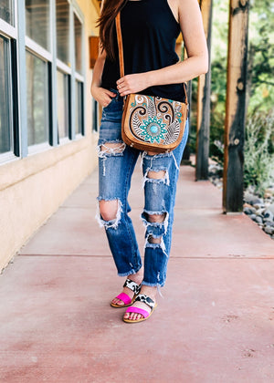 Brown Medium Flap Over Crossbody with Turquoise and Black Flowers on Brunette Model