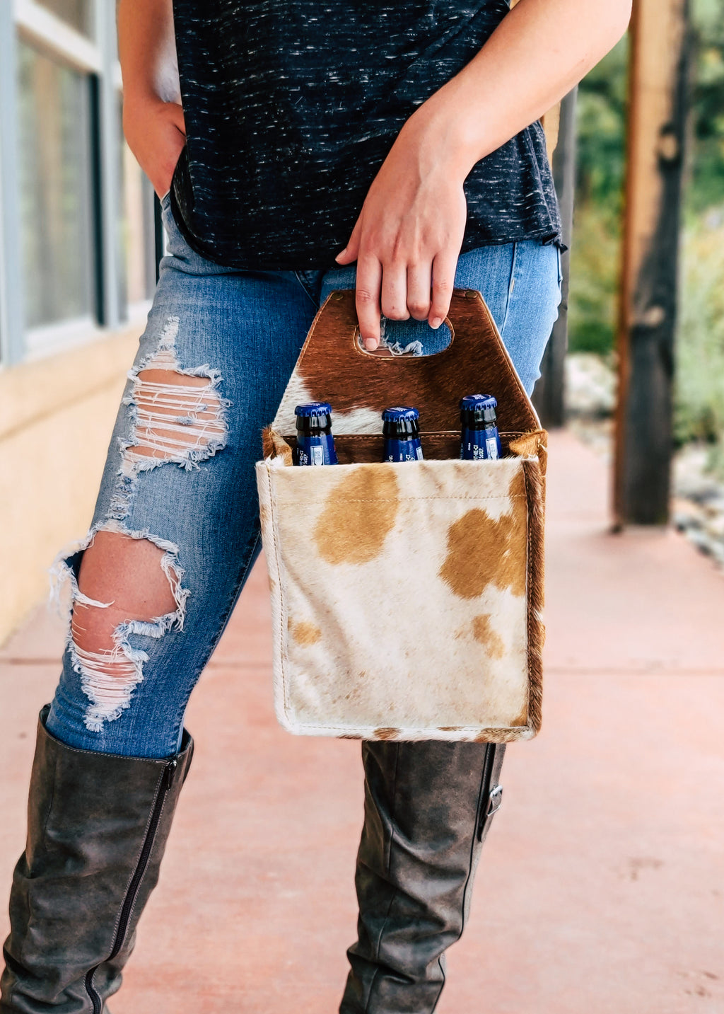 Brown & White Cowhide 6 BottleCan Caddy Taken Outside on Blonde Model