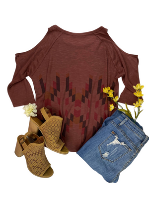 Back View of Burgundy Aztec Cold Shoulder Top Laid Flat on White Surface