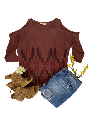 Front View of Burgundy Aztec Cold Shoulder Top Laid Flat on White Surface