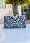 Charcoal Embroidered Aztec Wallet with Silver Accents Taken Outside on White Table