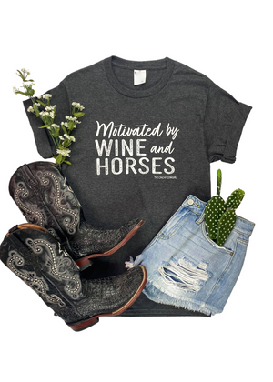 "Charcoal Short Sleeve Tee with ""Motivated by Wine and Horses"" Graphic in White Ink in the center"