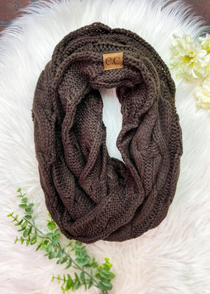 Chocolate Brown Cable Knit Infinity Scarf Laid Flat on White Carpet
