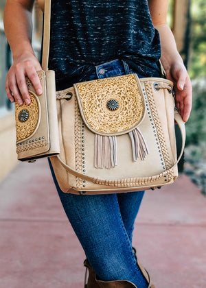 Concealed Carry Tan Mandala Tooled CrossbodyHobo Handbag & Wallet Set with Shoulder Strap and Crossbody Strap, Tan Fringe and Gun Metal Accents, Taken Outside in Natural Light on Blonde Model