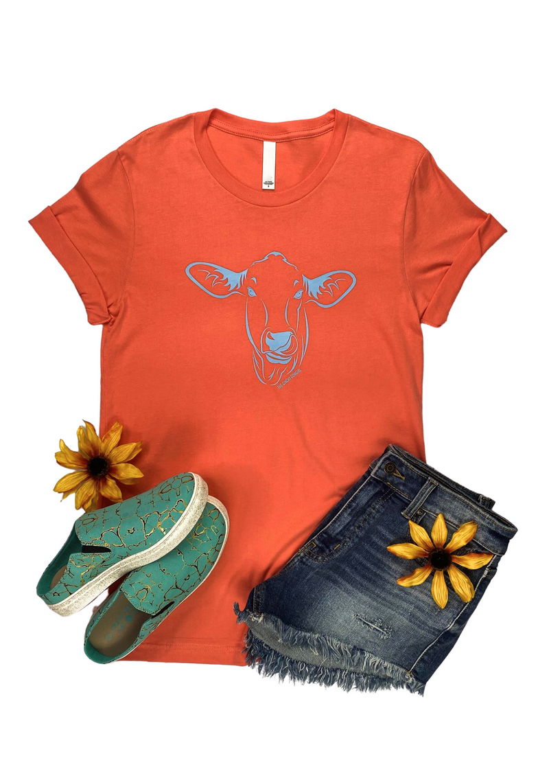 Coral Short Sleeve Tee with a Funny Cow Graphic in Light Blue Ink in the center