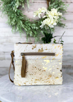 Small Clutch Handbag with Ivory Cowhide and Gold Spatter Pattern with Front Zipper Pocket and Wristlet Strap Taken Inside with Studio Lights