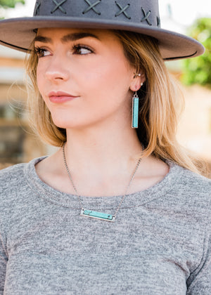 Silver Necklace with Turquoise Bar Necklace with Matching Turquoise Rectangle Bar Dangle Earrings with Fish Hook Backs, Taken Outside on Blonde Model in Natural Light