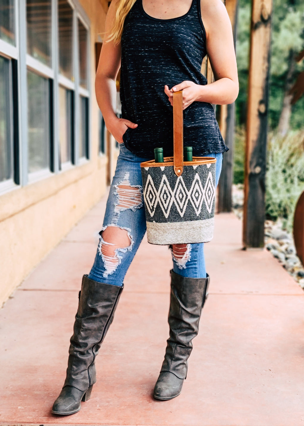 Grey Aztec & Cowhide 2 Bottle Caddy with Brown Leather Handle on Blonde Model Taken Outside