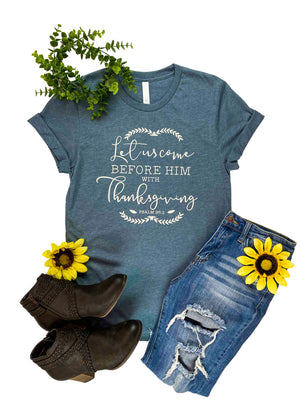 "Heather Slate Graphic Tee with "" Let Us Come Before Him With Thanksgiving Psalm 95:2"" Printed in Grey Ink, laid flat on white surface"