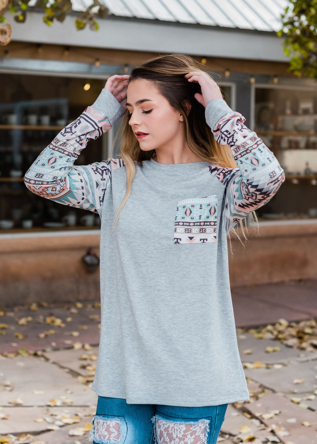 Heather Grey Aztec Long Sleeve Top with Aztec print front pocket on blonde model
