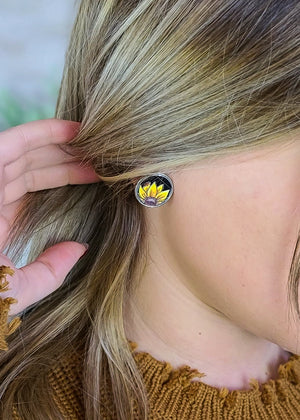 Small round stud leather post earrings with sunflower on blonde model