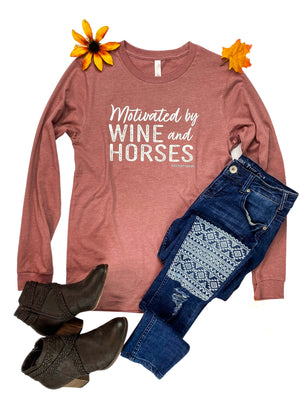 Motivated by Wine & Horses Long Sleeve Graphic Tee in color Mauve, Laid Flat on White Surface with Denim Jeans and Brown Boots, and Floral Accents