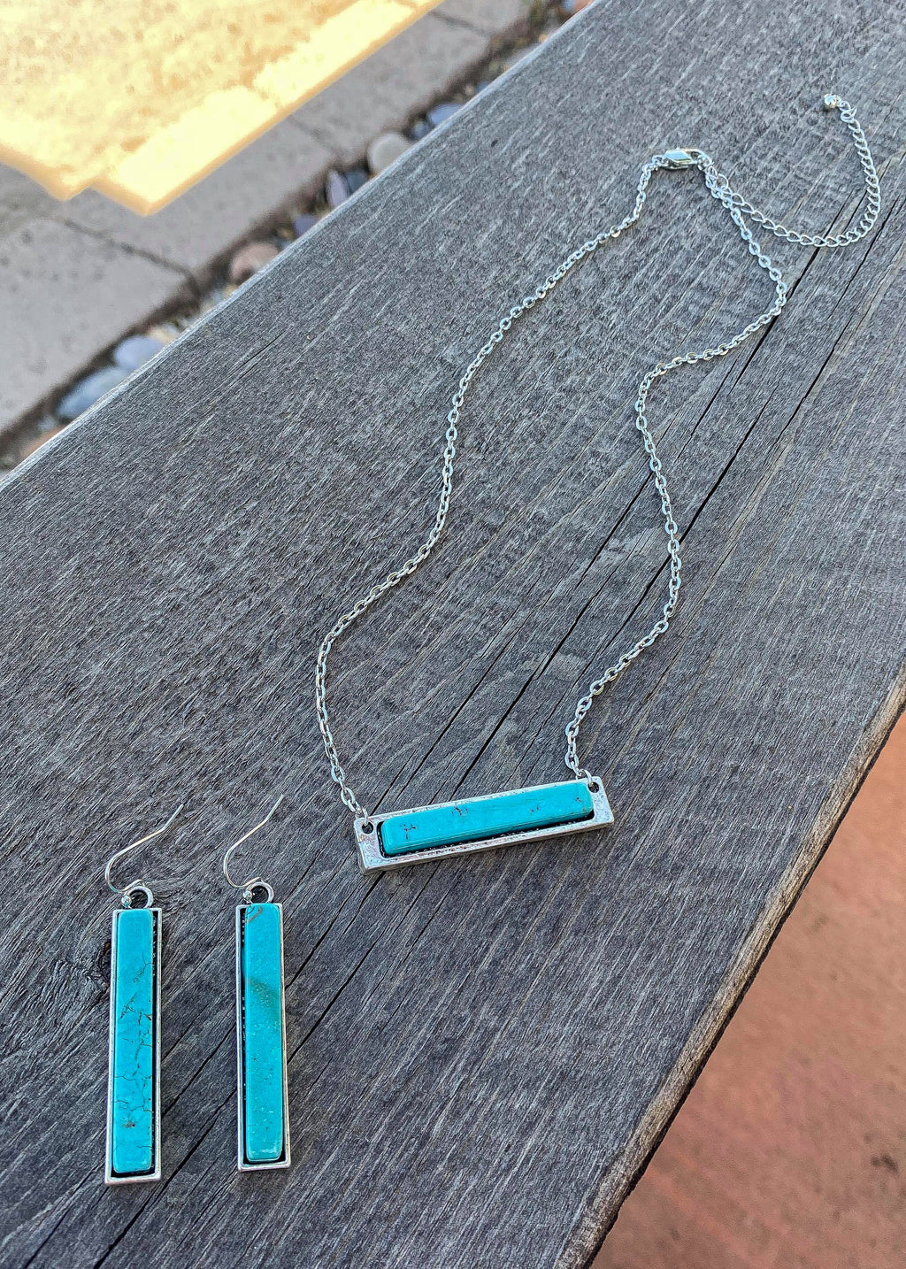 Silver Necklace with Turquoise Bar Necklace with Matching Turquoise Rectangle Bar Dangle Earrings with Fish Hook Backs, Taken Outside on Wood Surface in Natural Light