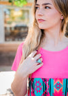 triangle shaped natural stone in turquoise color ring surrounded by rhinestones on blonde model