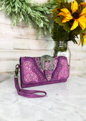 Purple and Pink Tri-Fold Wallet With Gold Studs and a Turquoise Buckle With Floral and Whipstitched Detail and a Wrislet Strap