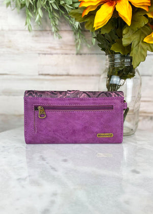 Back of Purple and Pink Tri-Fold Wallet With Gold Studs and a Turquoise Buckle With Floral and Whipstitched Detail and a Wrislet Strap and Back Zipper Pocket