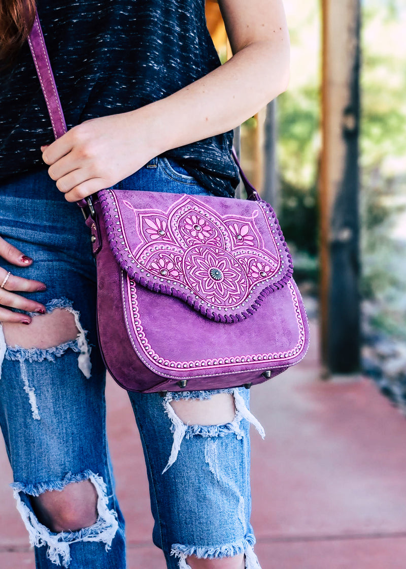 Medium Purple and Pink Crossbody With Embossed Floral Print and Whipstitched Stitching on Brunette Model