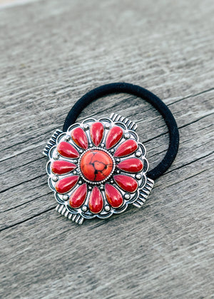 Red Concho Stone Hair Tie Taken Outside in Natural Lighting