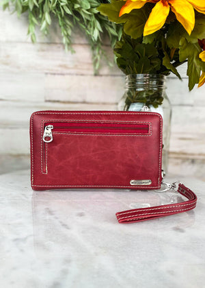 Back of Red Colored Zip Around Wallet with Floral Tooled Detail and Lace Silver Rhinestone Trim with Wristlet Strap and Back Zipper Pocket