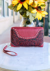 Red Colored Zip Around Wallet with Floral Tooled Detail and Lace Silver Rhinestone Trim with Wristlet Strap, Taken with Outside Lighting