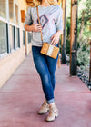 Small Tan & Brown Crossbody with Aztec Print with Wristlet Strap on Blonde Model,Taken Outside in Natural Lighting