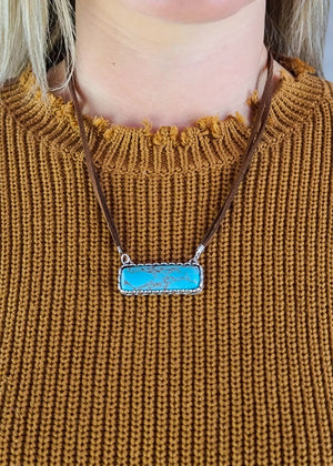 Turquoise Bar Brown Leather Necklace on blonde model