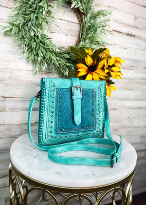 Medium Turquoise Colored Crossbody with Embossed Floral Print With Crossbody Strap