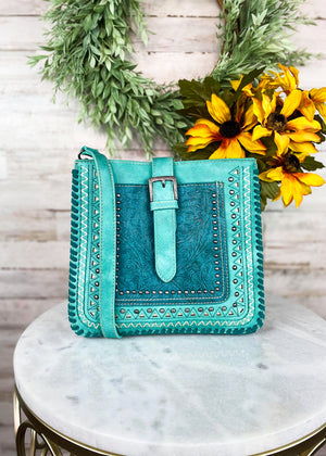 Medium Turquoise Colored Crossbody with Embossed Floral Print