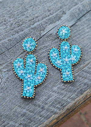Turquoise Cactus Stud Earrings with Seed Bead and Floral Detail and Gold Seed Bead, Taken Outside on Wood Surface in Natural Light