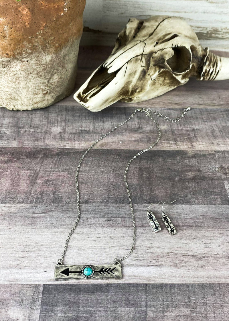 Silver Arrow Bar Necklace with matching dangle fish hook earrings on blonde model