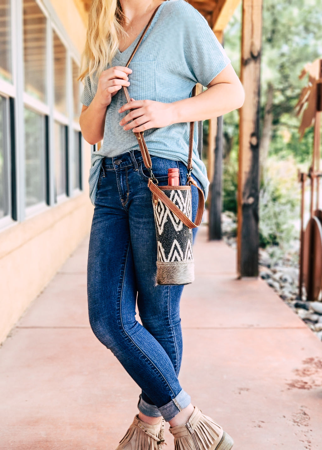 Aztec Cowhide Canvas Bottle Bag on model, outside