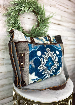 Baby Blues Cowhide Handbag, blue pattern, cowhide on sides, brown leather strap and details