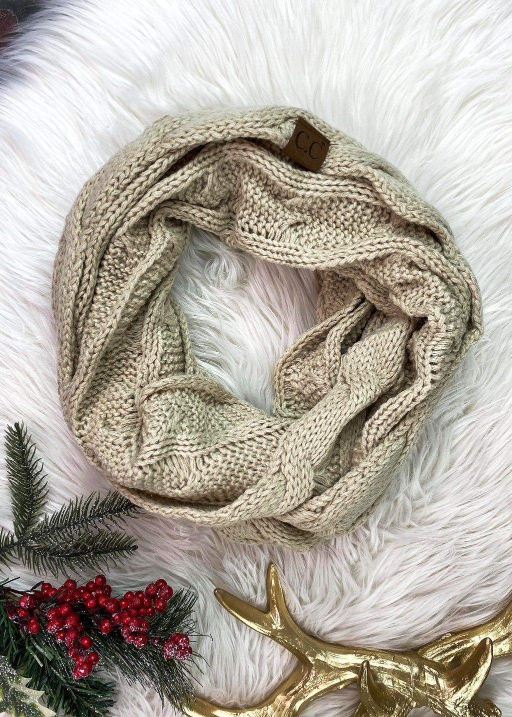 Beige Cable Knit Infinity Scarf on rug