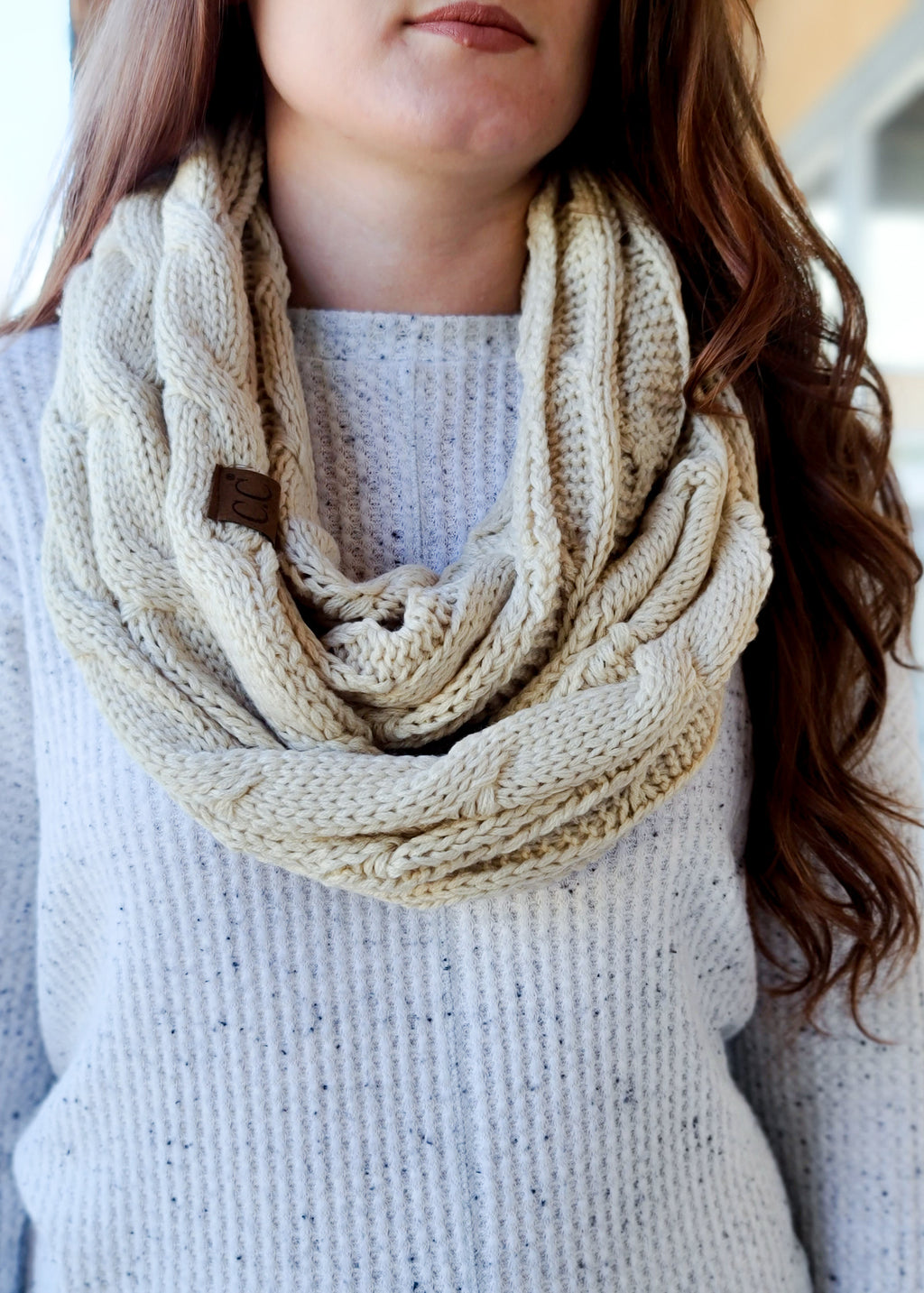 Beige Cable Knit Infinity Scarf on model