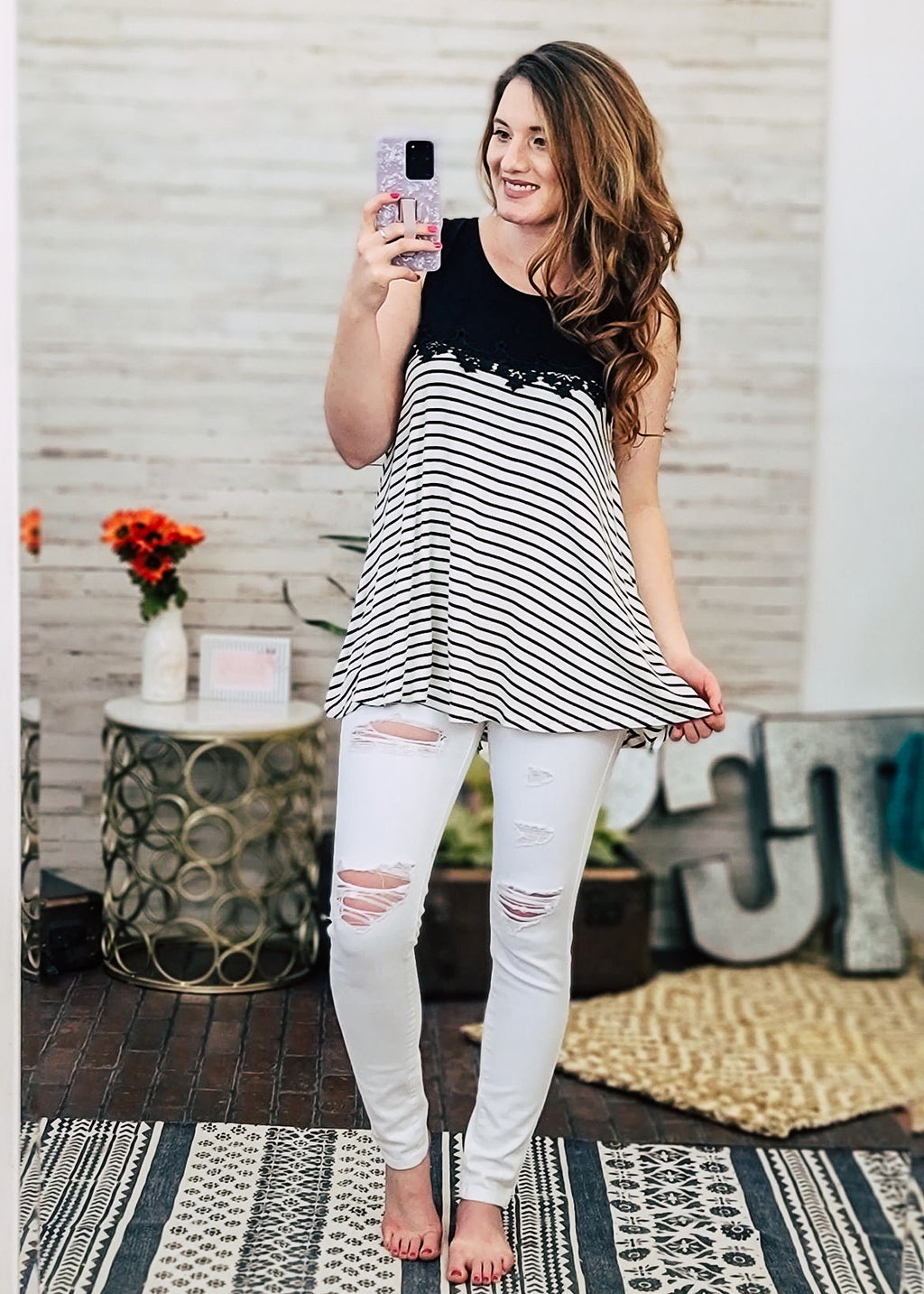 Black & Ivory Stripped Lace Tank Top on brunette model with white distressed jeans