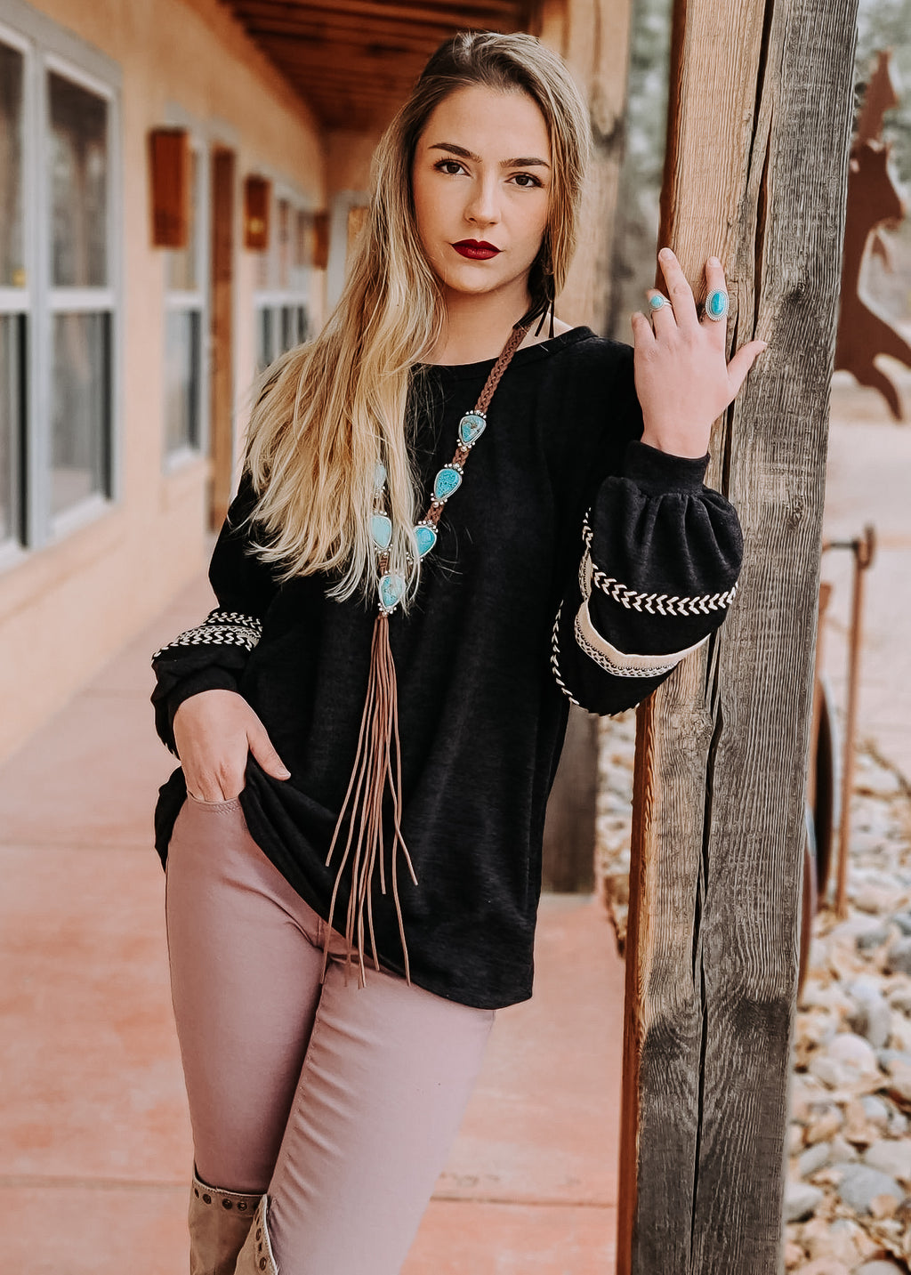 Black Knit Balloon Long Sleeve Top on model with accessories
