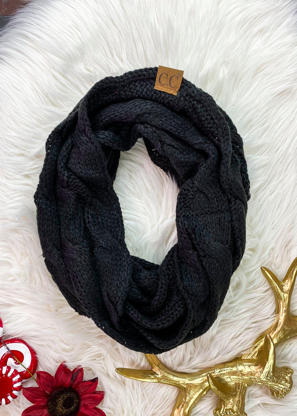 Black Cable Knit Infinity Scarf on white rug