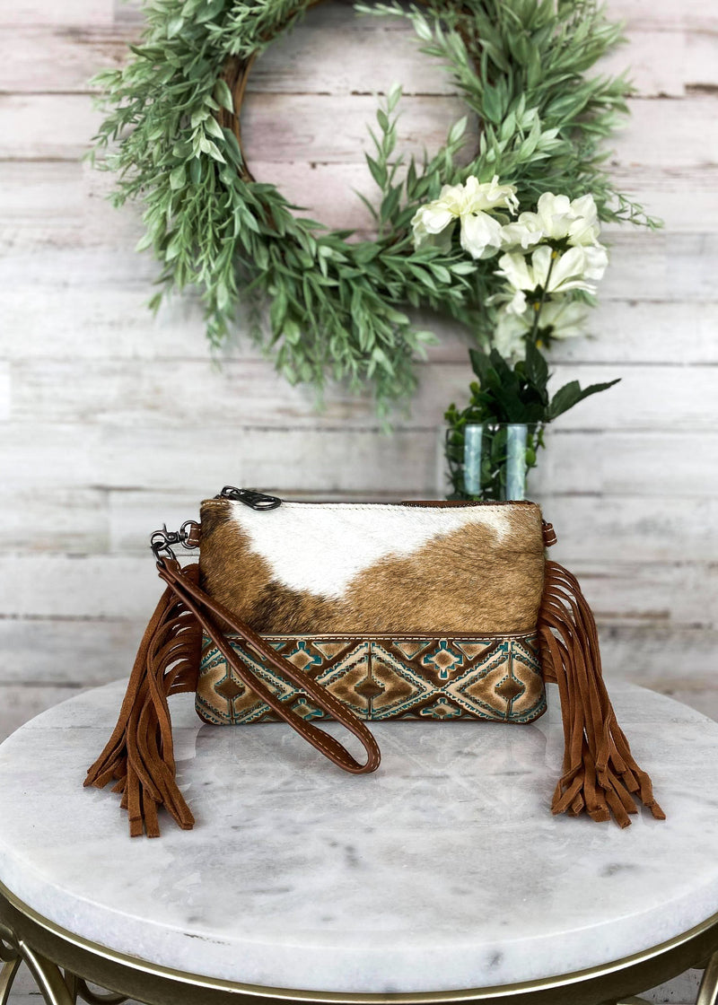 Brown & White Cowhide Aztec Clutch Crossbody Handbag, looking down into bag inside
