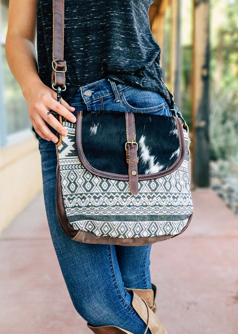 Brown Canvas Cowhide Aztec Crossbody on model, outside