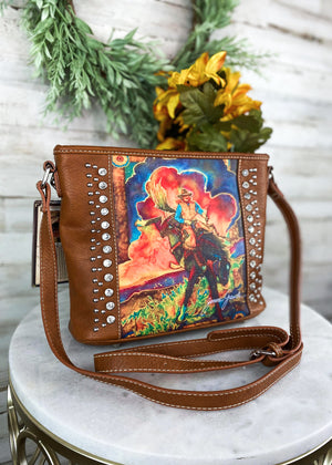 Brown Colorful Bronc Crossbody Handbag on table
