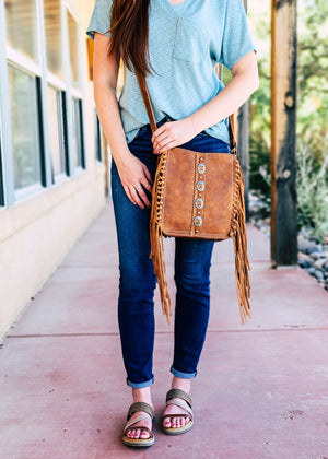 Concealed Carry Brown Concho Fringe Crossbody Handbag with model