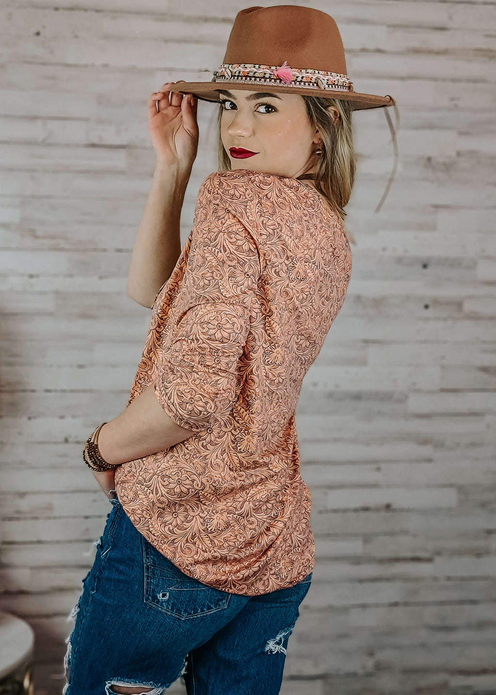 Tooled Leather V Neck 3/4 Sleeve Top on blonde model with accessories