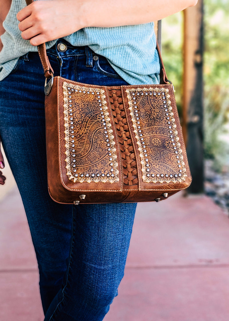 Brown Vintage Floral Embossed Crossbody on model