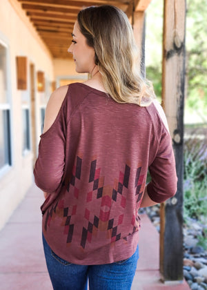 Burgundy Aztec Cold Shoulder Top blonde model with denim jeans, shot outside on patio