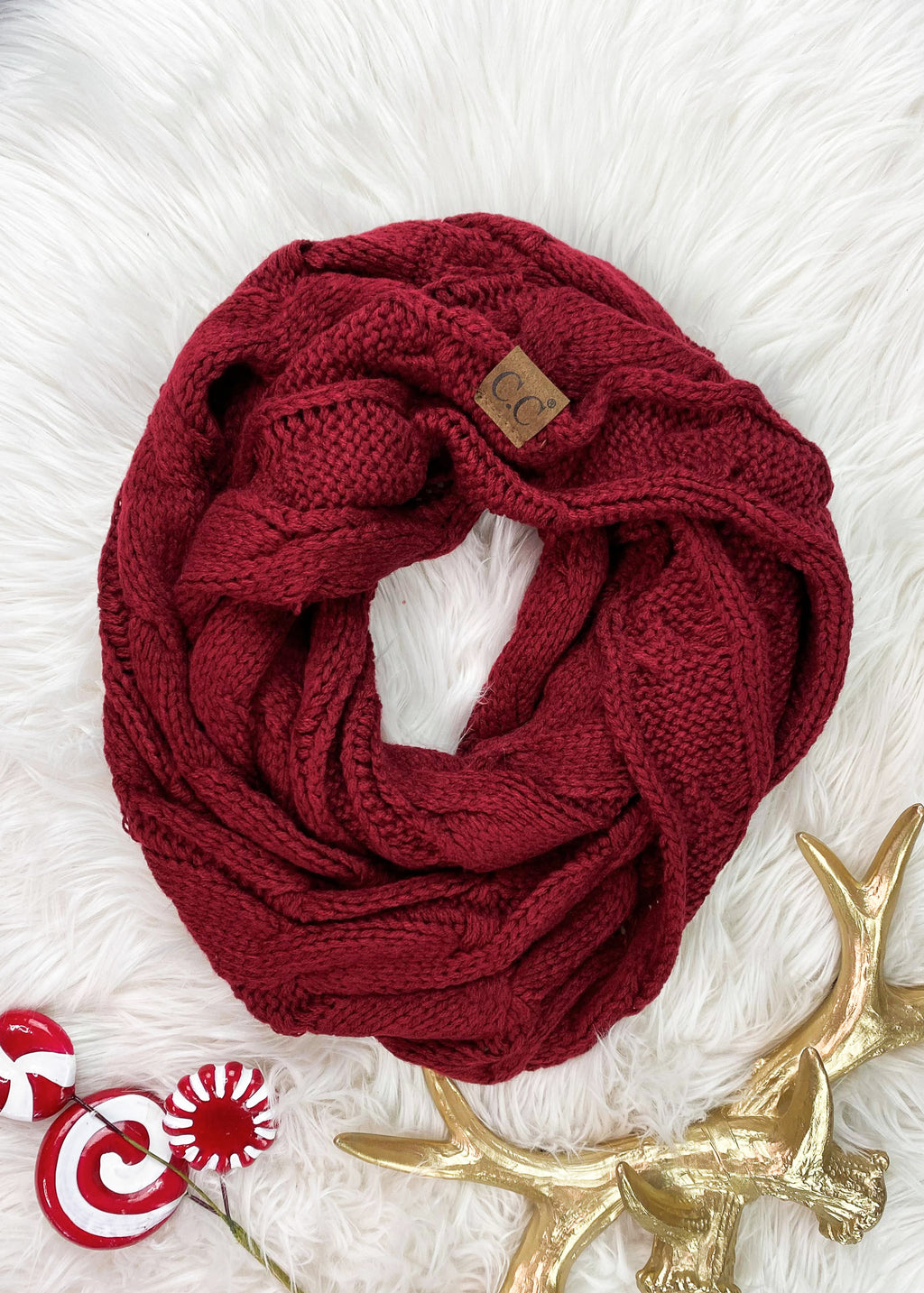 Burgundy Cable Knit Infinity Scarf on rug