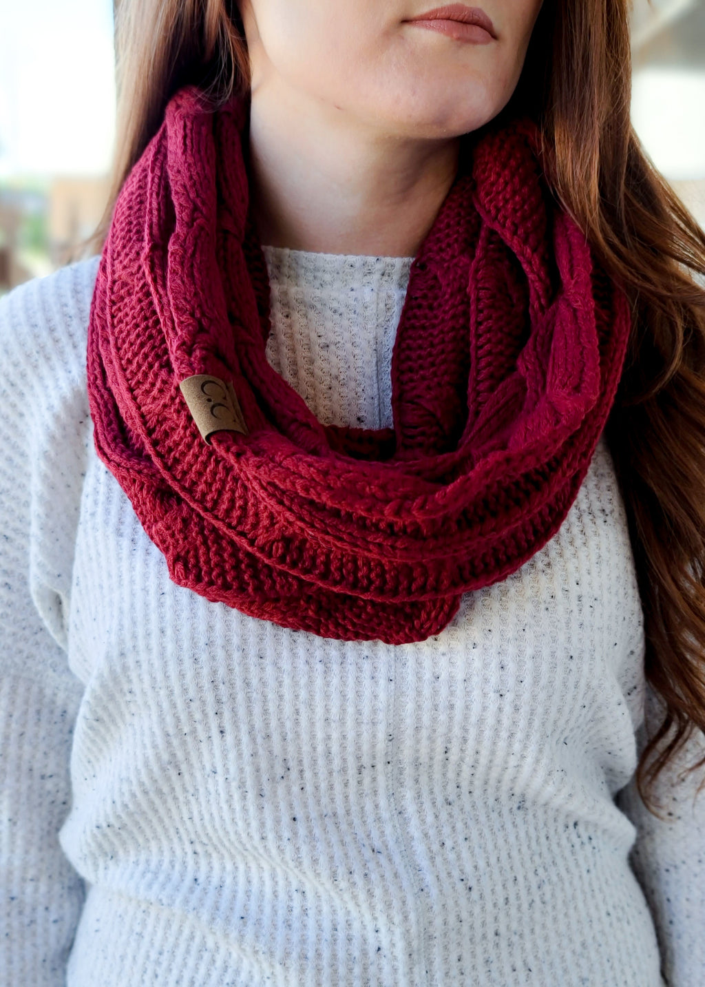 Burgundy Cable Knit Infinity Scarf on model