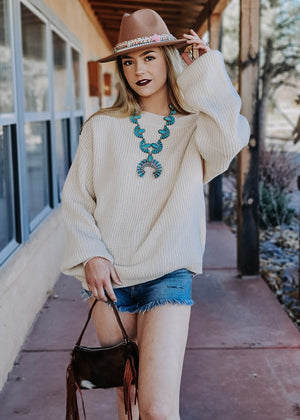 Cream Button Slouchy Sweater on blonde model with accessories