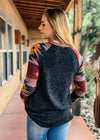 Grey Aztec Raglan Long Sleeve Top with blonde model, shot outside