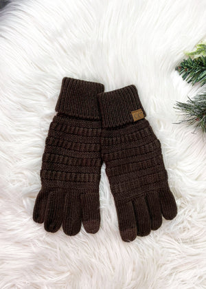 chocolate brown gloves on rug